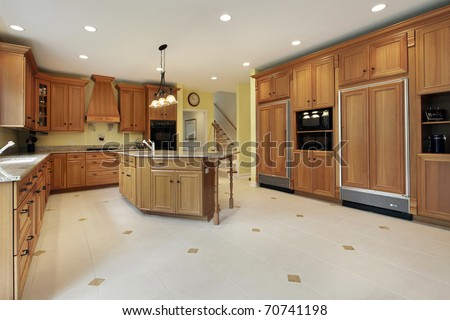 Large Kitchen In Luxury Home With Oak Cabinetry Stock Photo