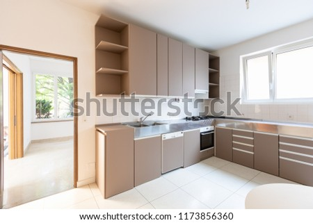 Large kitchen with bright window, nobody inside