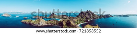 Large landscape from group of island from Indonesia. Aerial view of panoramic nature scene with colorful water and land. Concept of freedom drone picture of idyllic place in Indonesia #721858552