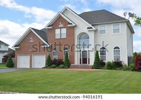 Large  Landscaped Two Car Garage Luxury Suburban Home in Residential District