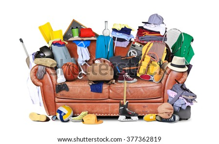 Large leather sofa with a bunch of different things #377362819