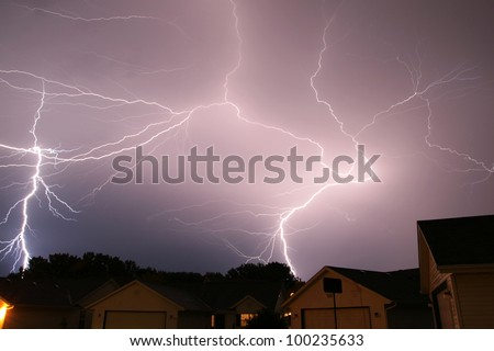large lightning strikes filling sky