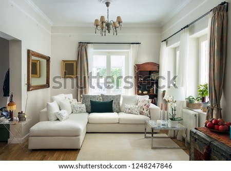 Large living room very bight  with oak wooden floor, four seats sofa, white carpet and retro objets, Greece. Photo stock ©