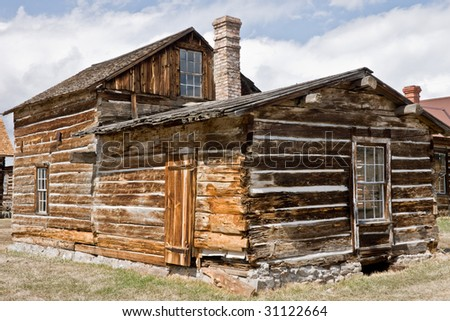 Large log house with brick chimney in the ghost town of for Log and brick home