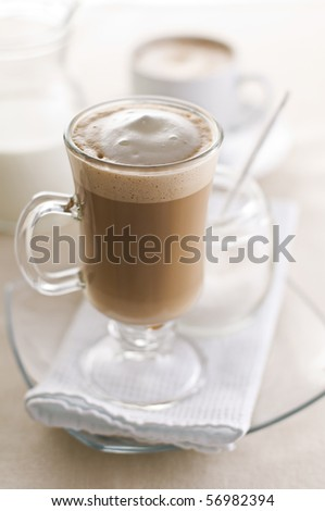 Large macchiato with cream and sugar close up