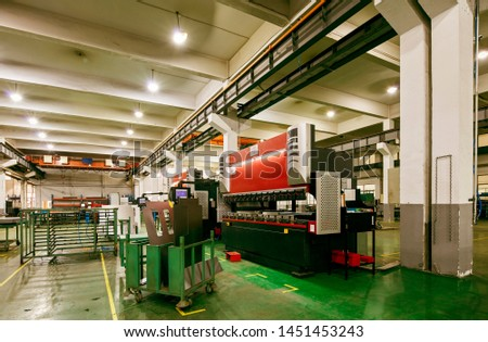 Large machines in large manufacturing plants #1451453243