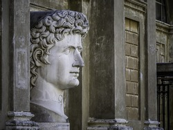 Large marble head with damaged nose in Vatican Museum, Rome, Italy