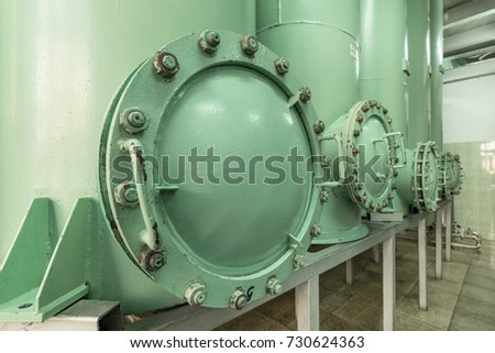 Large, massive inspection hatch in a sand filter. Industrial filtering equipment. #730624363