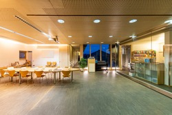 large meeting room in wood office building with acoustic ceiling and sliding glass partition walls