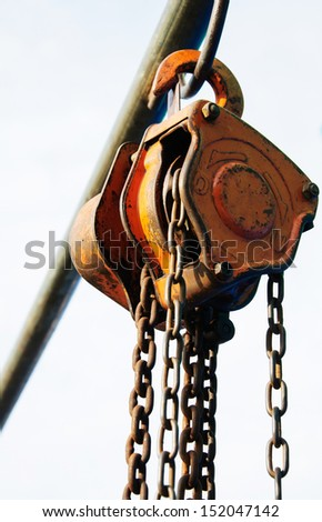 Large metal hook and chains attached to a pulley