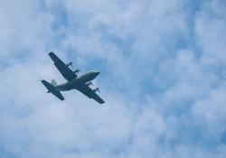 Large military cargo plane flying over Bucharest. Plane prepairing for landing.
