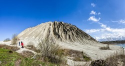 Large mining Spoil tip hill near abandoned Soviet time prison in Rummu quarry, Estonia. Panoramic montage from 3 HDR images