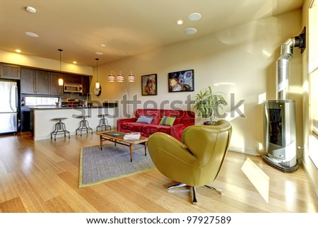 Large modern living living with kitchen and  hardwood floor.