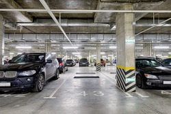 Large modern underground parking for cars. New underground car parking, garage