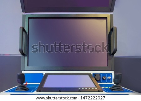 Large monitors in the workplace. Supervisory console. Monitoring of the production process at the plant. Control levers on the remote. Visual observation #1472222027