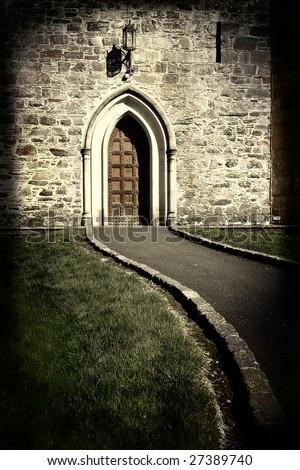 large moody church door in sepia tone