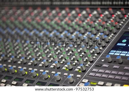 Large Music Mixer desk in recording studio. Closeup
