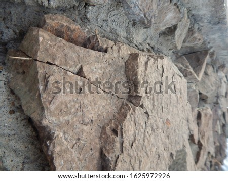 large natural rough stone in rough textured masonry