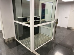 Large new inclusive elevator in the metro or shopping center for people with disabilities and people with disabilities for a barrier-free city environment.