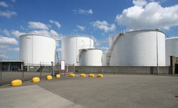 Large oil silo's along the road in Rotterdam harbor area