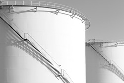 Large oil tank black and white .