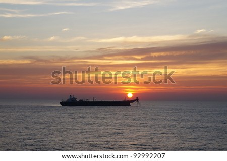 Large oil tanker anchored in the middle of sea in the evening