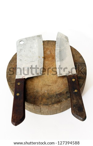 large old chef's knife on chopping block - stock photo