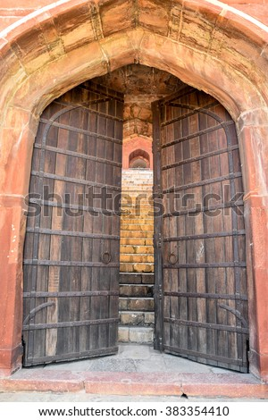 Large Old Gate With Wooden Doors #383354410