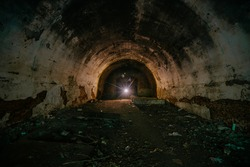 Large old historical underground red brick tunnel.