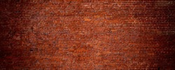 Large Old Red Brick Wall Background. Wide Angle Vintage Brick Texture. Panoramic Web banner or Wallpaper With Copy Space.