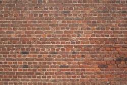 large old red weathered brickwall horizontal