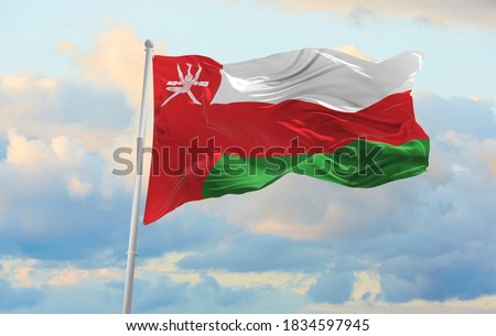 Large Oman flag waving in the wind