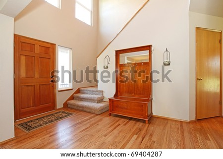 large open entrance with beautiful wood doors