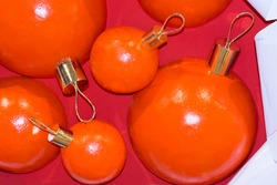Large orange decorative balls during New Year celebration. Festive wallpaper or card.