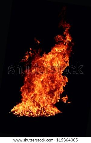 Large orange flame isolated over black background