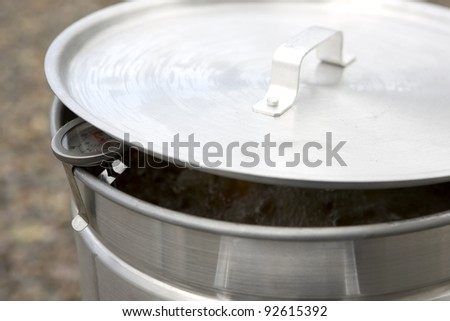 Large Outdoor Deep Frying Pot with Thermometer - stock photo