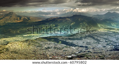 LARGE PANORAMA OF QUITO WITH COTOPAXI VOLCANO IN THE BACKGROUND