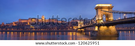 Large panorama of the Chain bridge and the castle in evening lights.