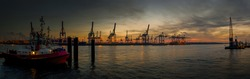 Large panorama of the Hamburg harbor in the early evening in autumn