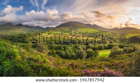 Large panorama with beautiful sunset, dramatic sky at the foothill of Carrauntoohil mountain, MacGillycuddys Reeks mountains, Ring of Kerry, Ireland Stok fotoğraf ©