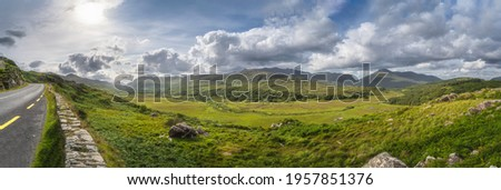 Large panorama with road in Molls Gap, Owenreagh River valley, MacGillycuddys Reeks mountains and farms, Wild Atlantic Way, Ring of Kerry, Ireland Stok fotoğraf ©