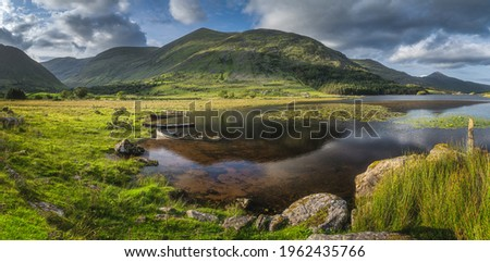 Large panorama with sunken paddle boats in Lough Gummeenduff. Beautiful Black Valley at sunset, MacGillycuddys Reeks mountains, Ring of Kerry, Ireland Stok fotoğraf ©