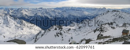 Large panoramic view of the french mountains from the Caron peak - Val Thorens - France - The Alps. - stock photo