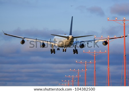 Large passenger airplane approaching runway