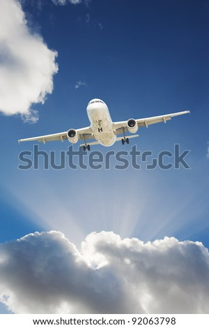 Large passenger airplane flying in the blue sky
