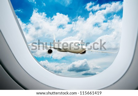 Large passenger plane flying in the blue sky