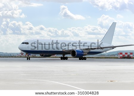 large passenger plane was taxiing for take-off in summer