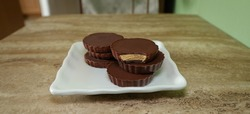 large peanut butter chocolate cups on a white plate