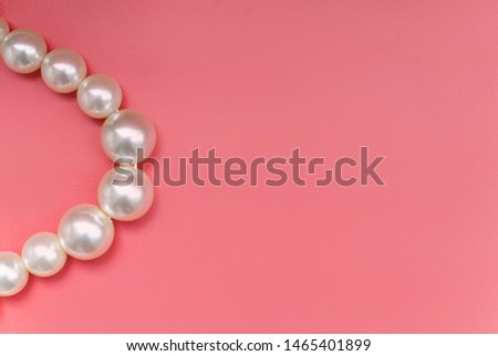 Large pearl on a pink background #1465401899
