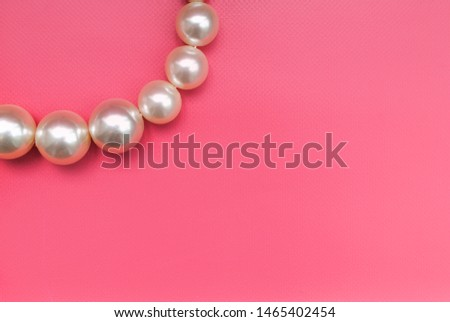 Large pearl on a pink background #1465402454